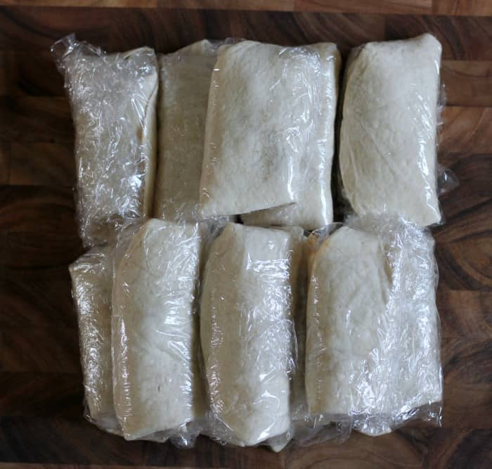 DIY freezer burritos wrapped in saran wrap