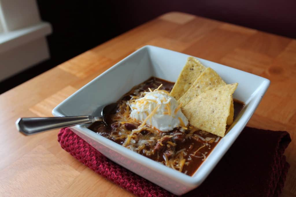 ... slow cooker recipe for beef and refried bean chili with salsa and lime