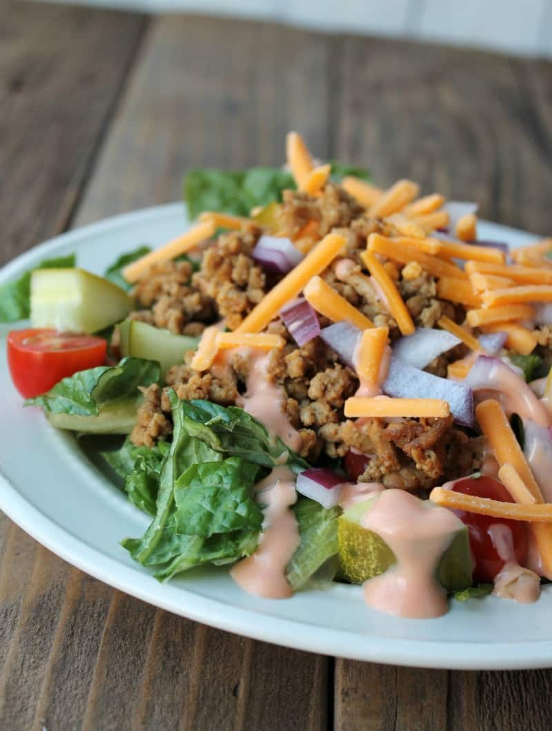 Lightened Up Cheeseburger Salad. 333 calories. Low carb and high protein. Delicious make-ahead salad. Mason jar salad instructions included.