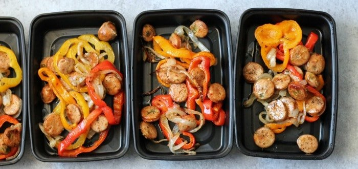 Sheet pan sausage and veggies portioned out into individual servings for the week.