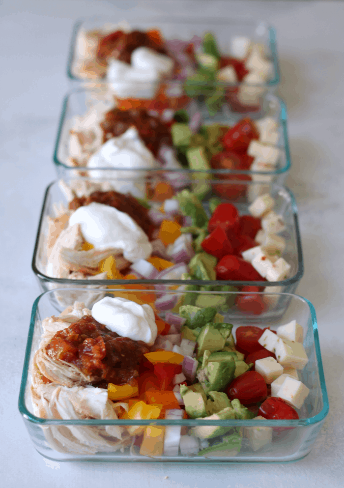 chicken burrito bowl meal prepped into containers