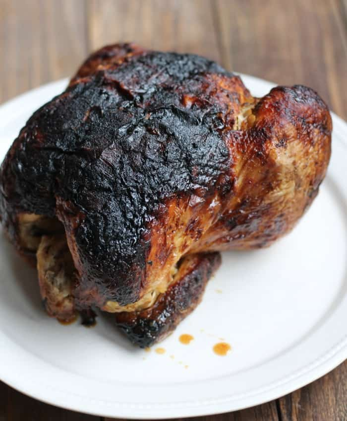 Rotisserie chicken served on a white plate