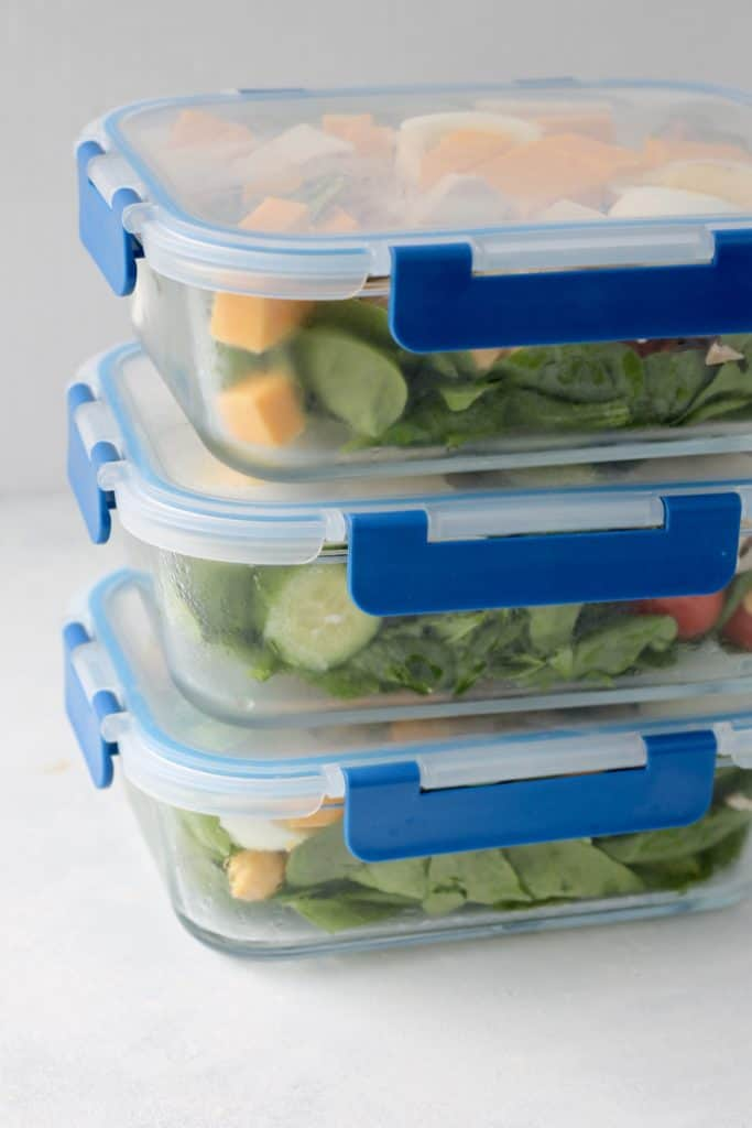 glass meal prep containers with salad