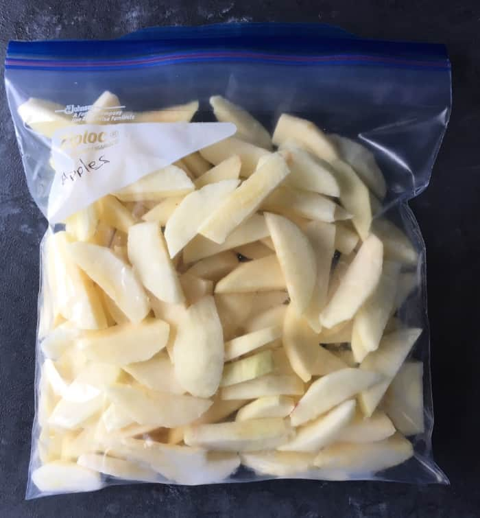 Ziplock bag filled for storing apples in the freezer.