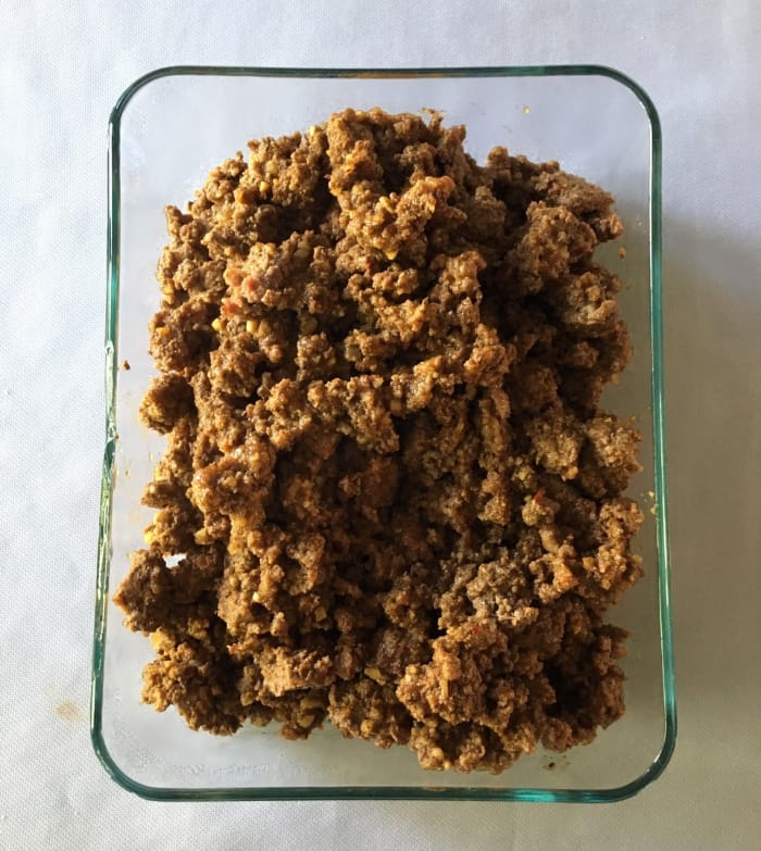 Ground turkey in a glass container for a quick meal prep idea.