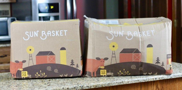 sun basket boxes on the kitchen counter