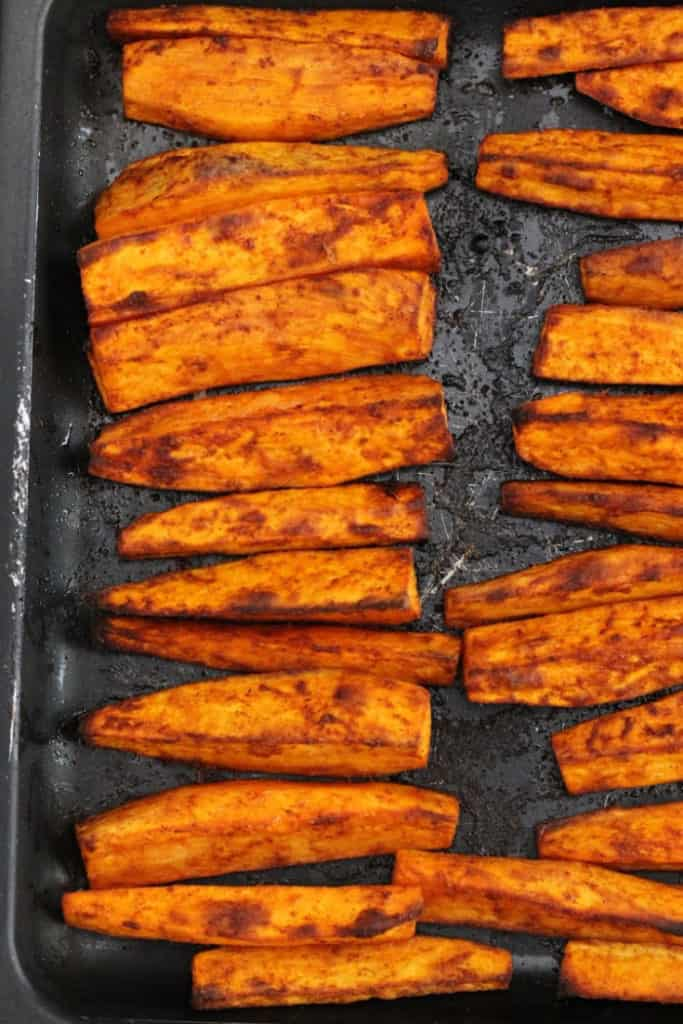Sweet potato wedges on a baking pan fresh out of the oven.