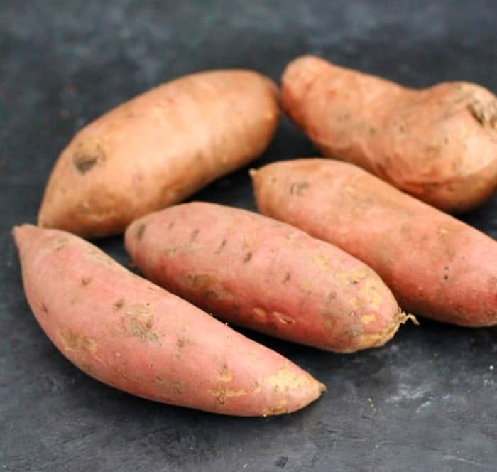 Sweet potatoes with skin on, prior to roasting.