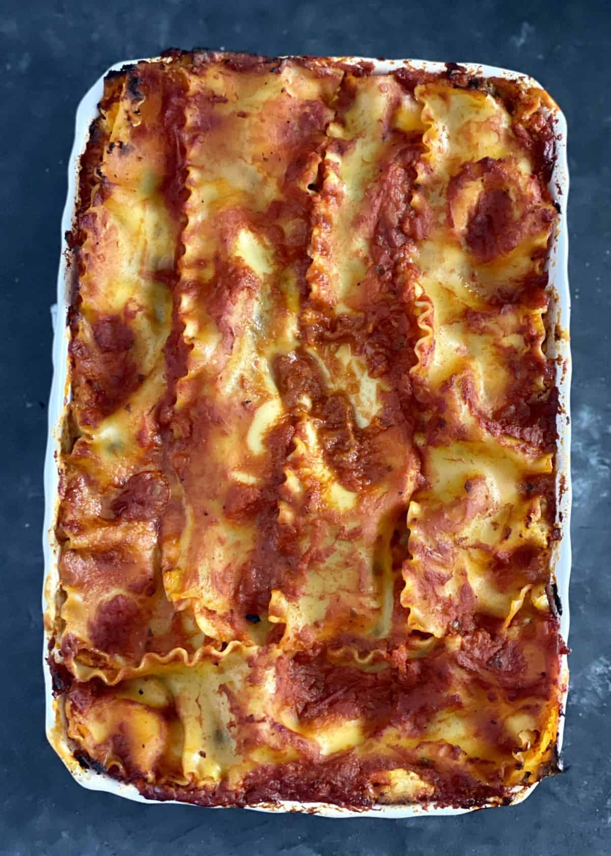 Baked veggie lasagna in a dish.