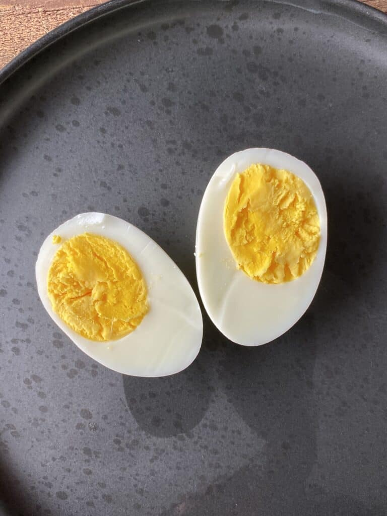 Halved hardboiled eggs on a plate