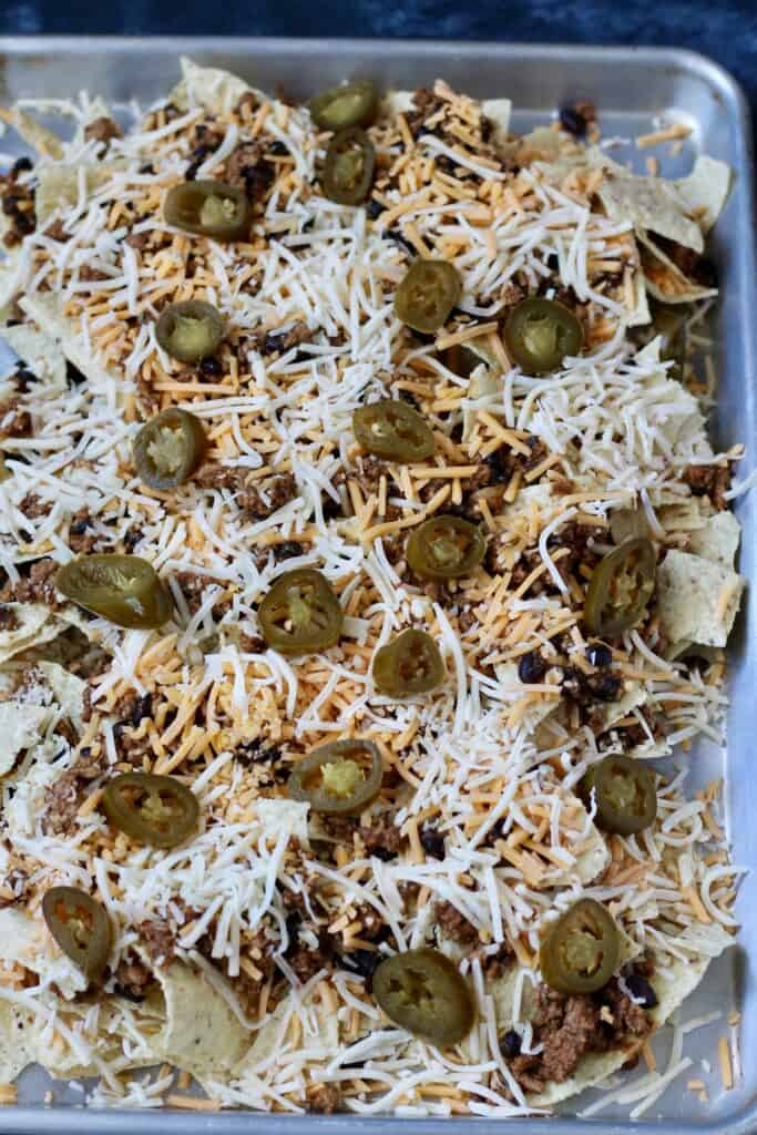 Sheet pan nachos with ground turkey prior to going in the oven.
