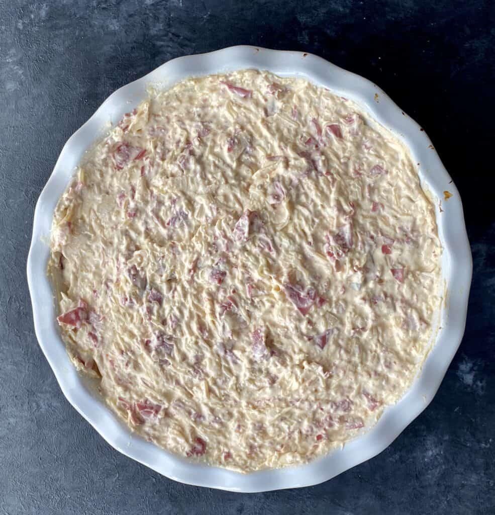 Baked Reuben dip in a round casserole dish