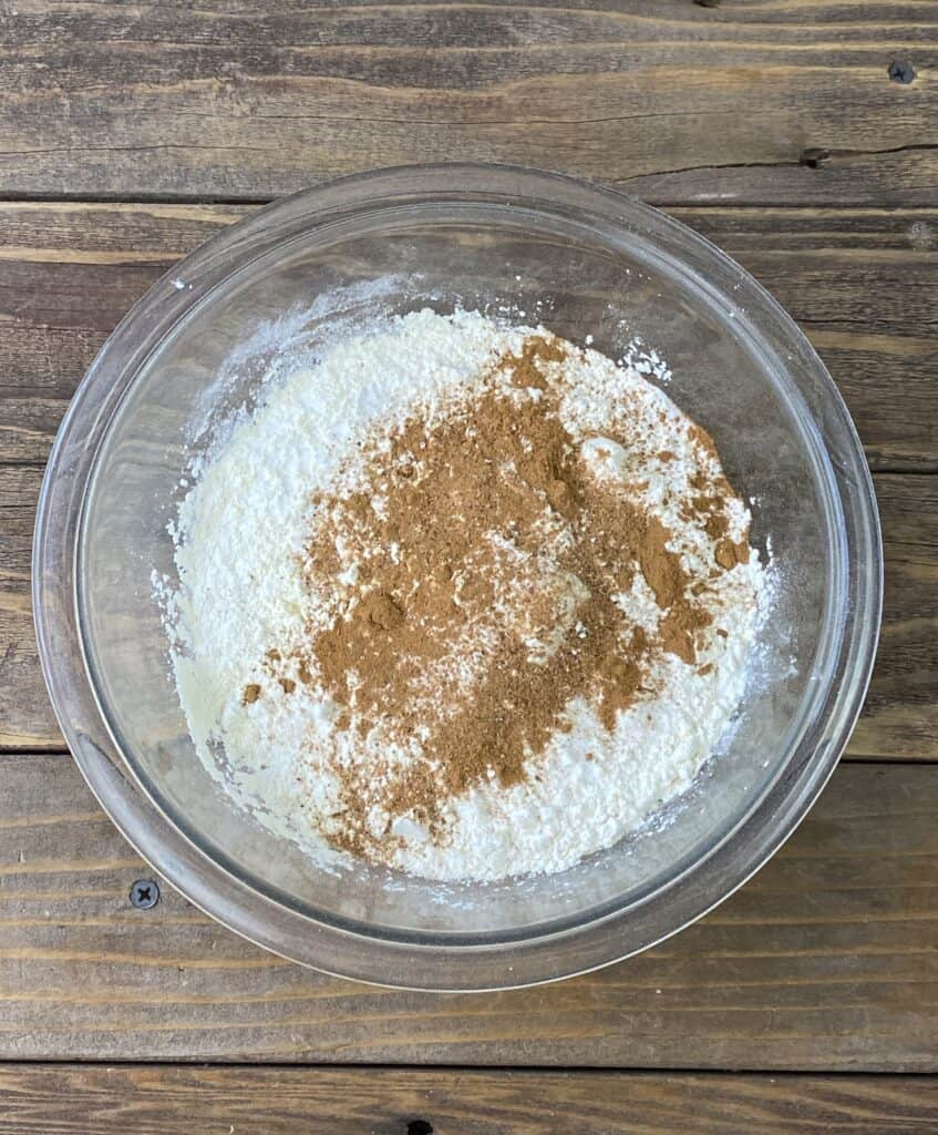 Dry ingredients for a healthy carrot cake in a glass bowl