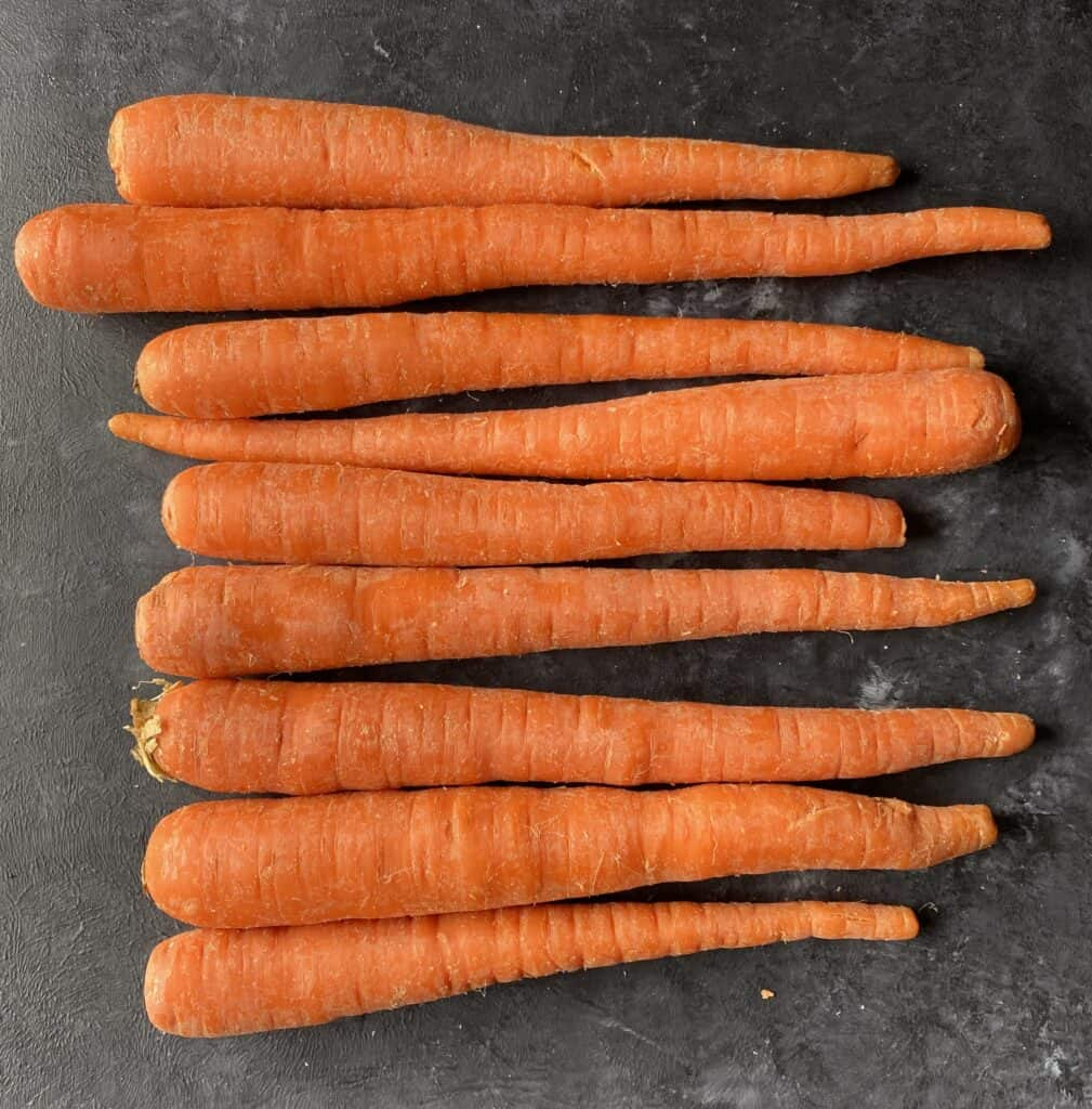 raw carrots on gray table