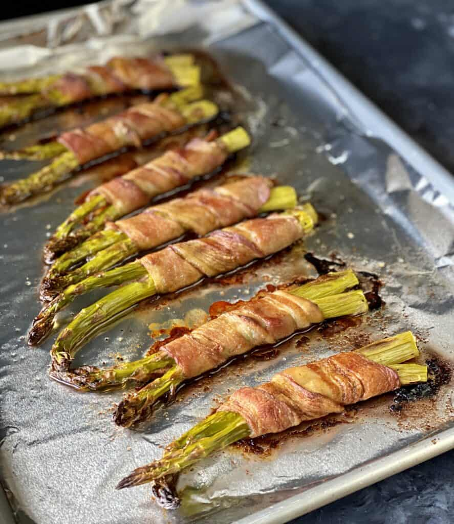 roasted bacon-wrapped asparagus on foiled pan