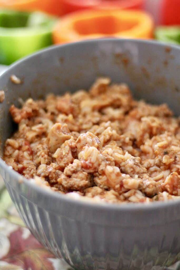 Ground turkey and sausage in a bowl with sauce