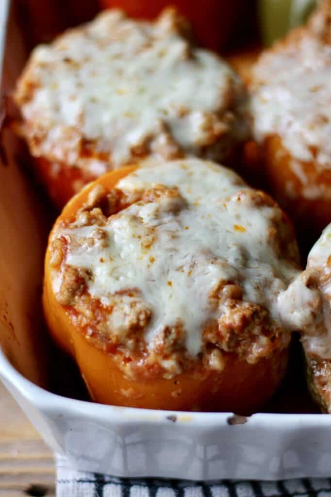 Close up of a baked stuffed Italian pepper with melted cheese