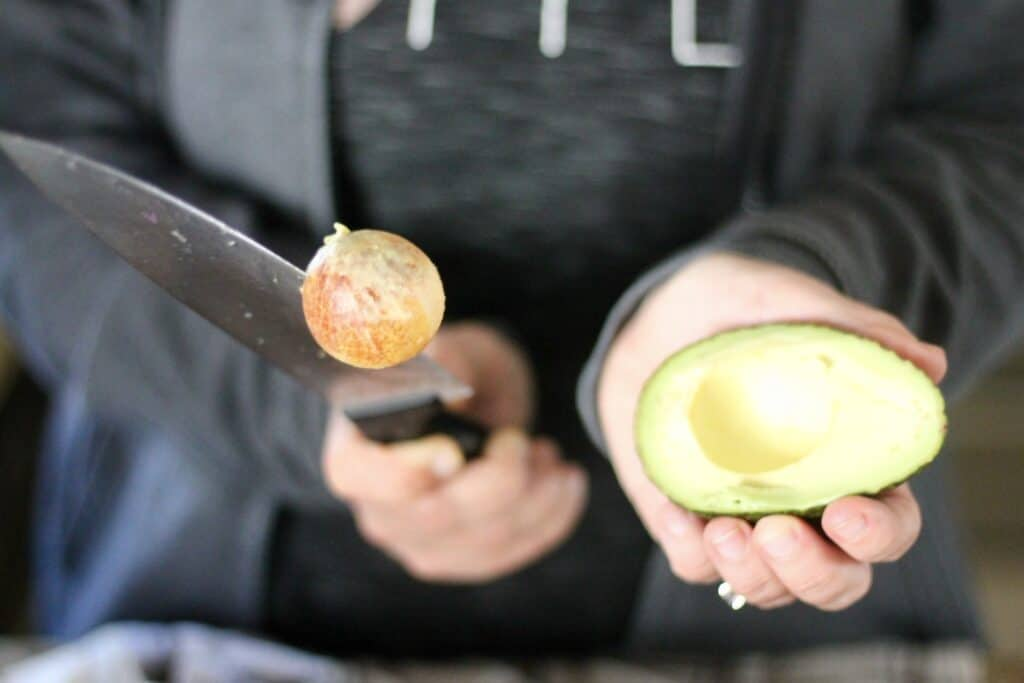 Removing an avocado pit with a knife