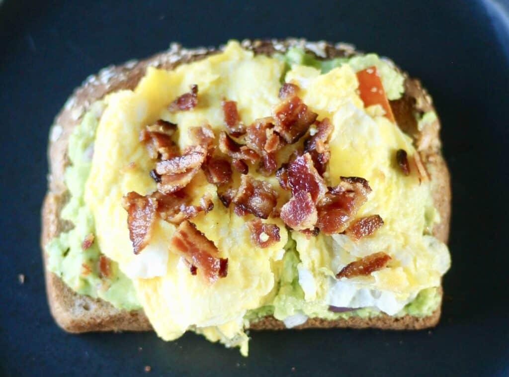 Avocado toast ideas ideas - layer toast with mashed avocado, scrambled egg, and bacon