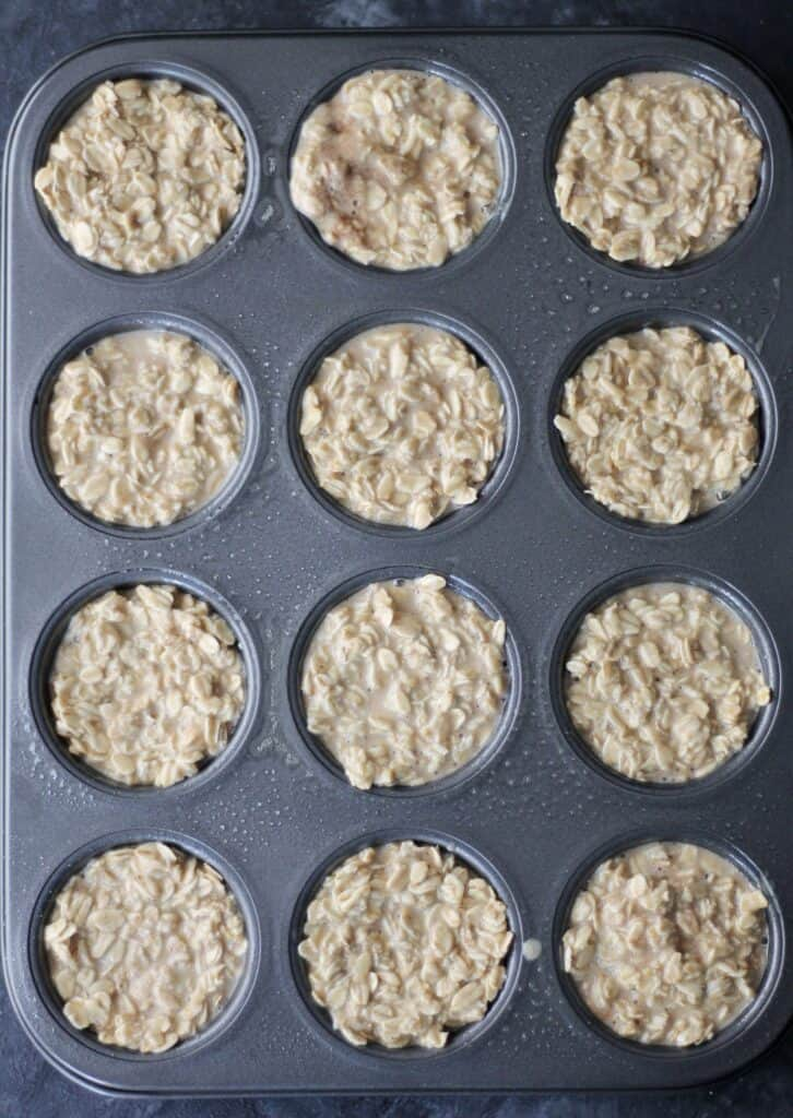 Oatmeal portioned out into a muffin tin