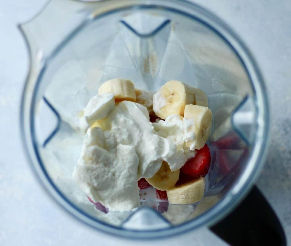 Blender with banana, strawberry and yogurt at the bottom