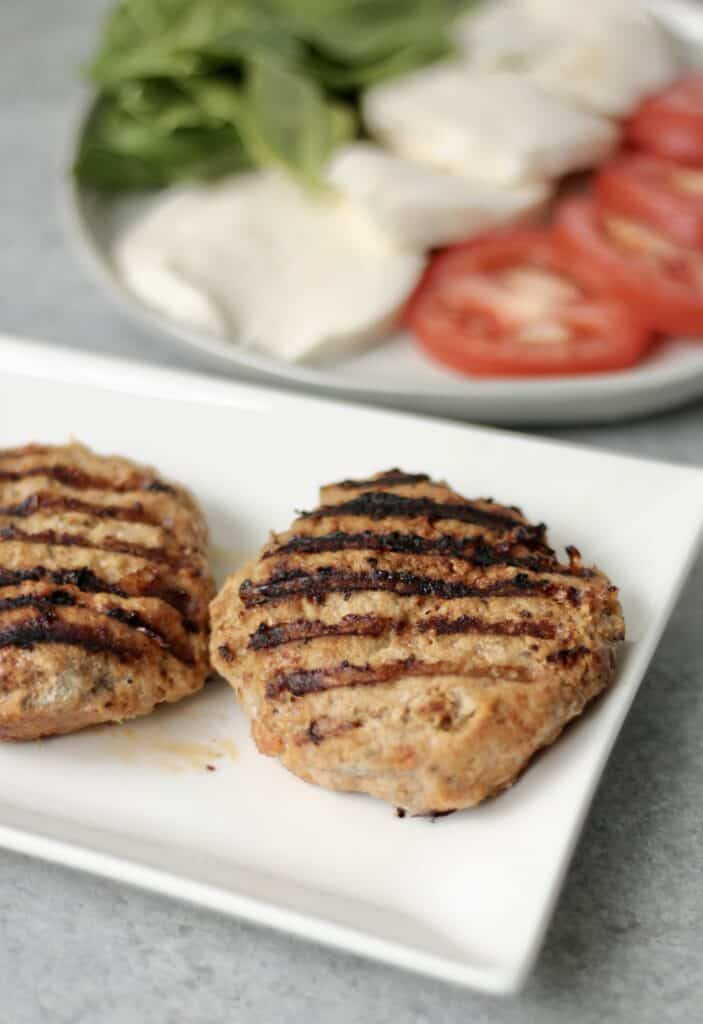 Juicy ground turkey burger patties on a plate