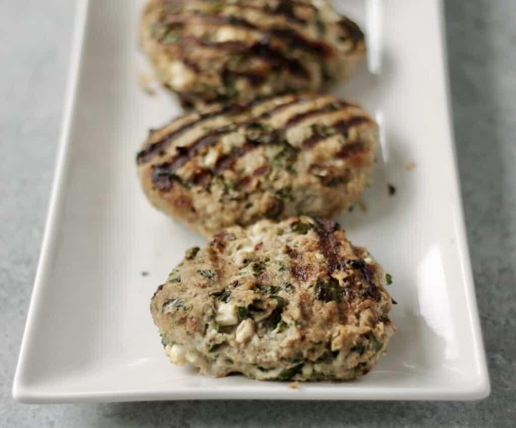 turkey burger patties on a white plate