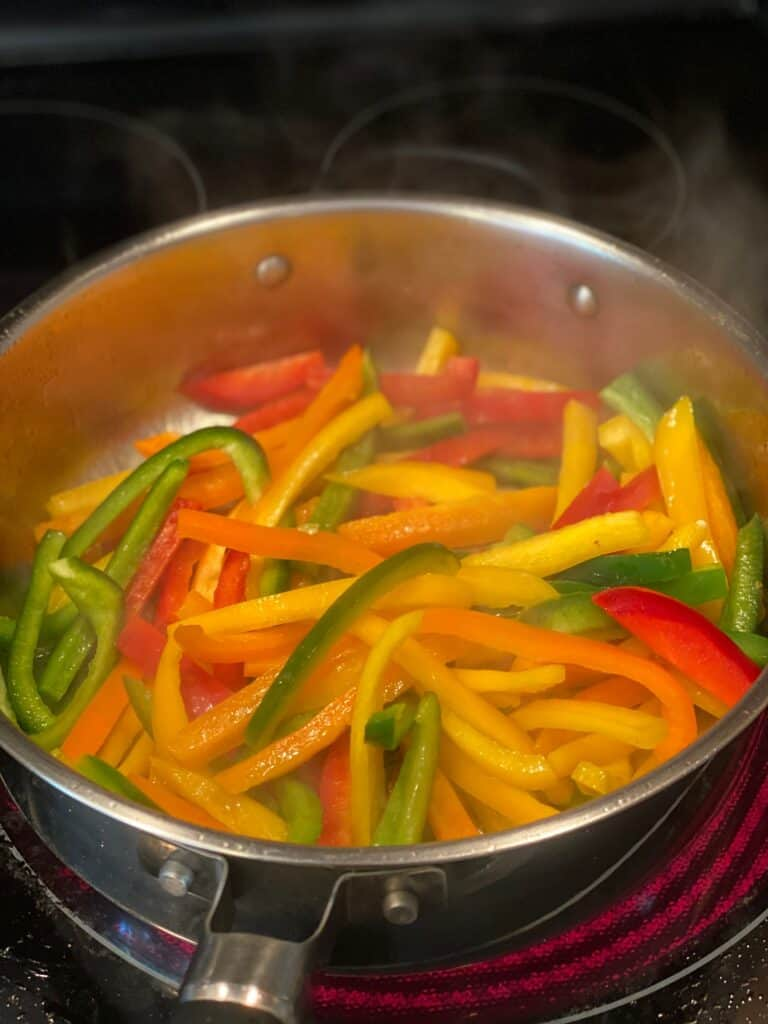sliced peppers cooked in a pan