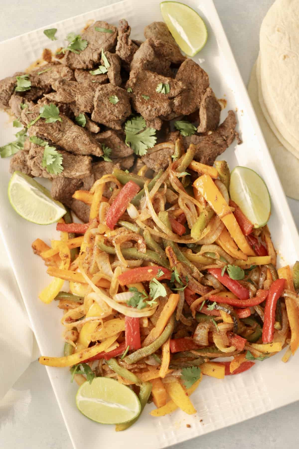 Butcherbox steak fajitas on a platter
