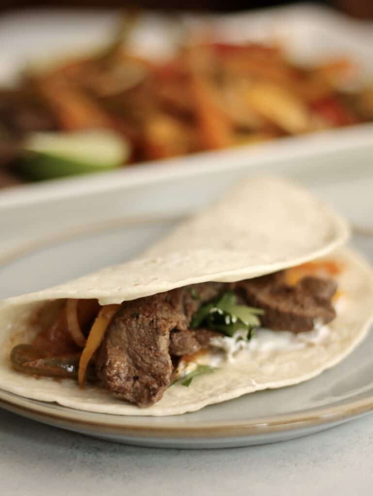 steak and peppers in a tortilla