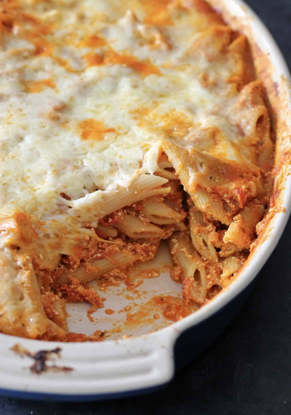 baked ziti with a scoop taken out of it