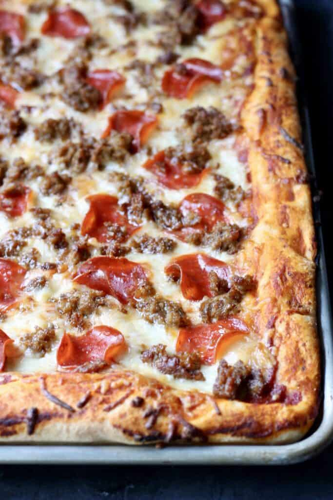 sheet pan pizza with pepperoni and turkey sausage