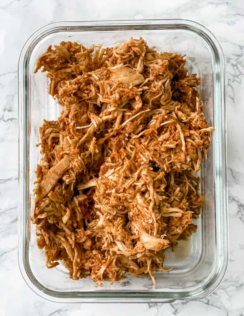 shredded taco chicken in a meal prep container