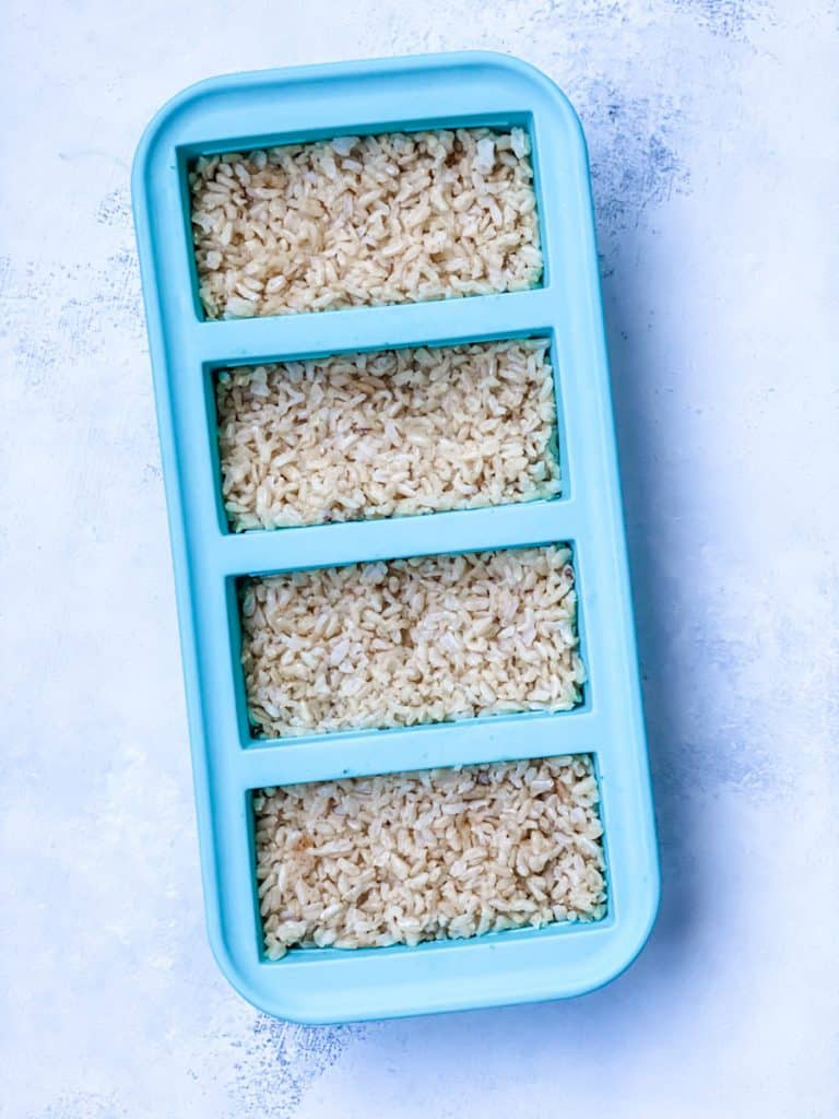 rice in a silicone tray to go into the freezer