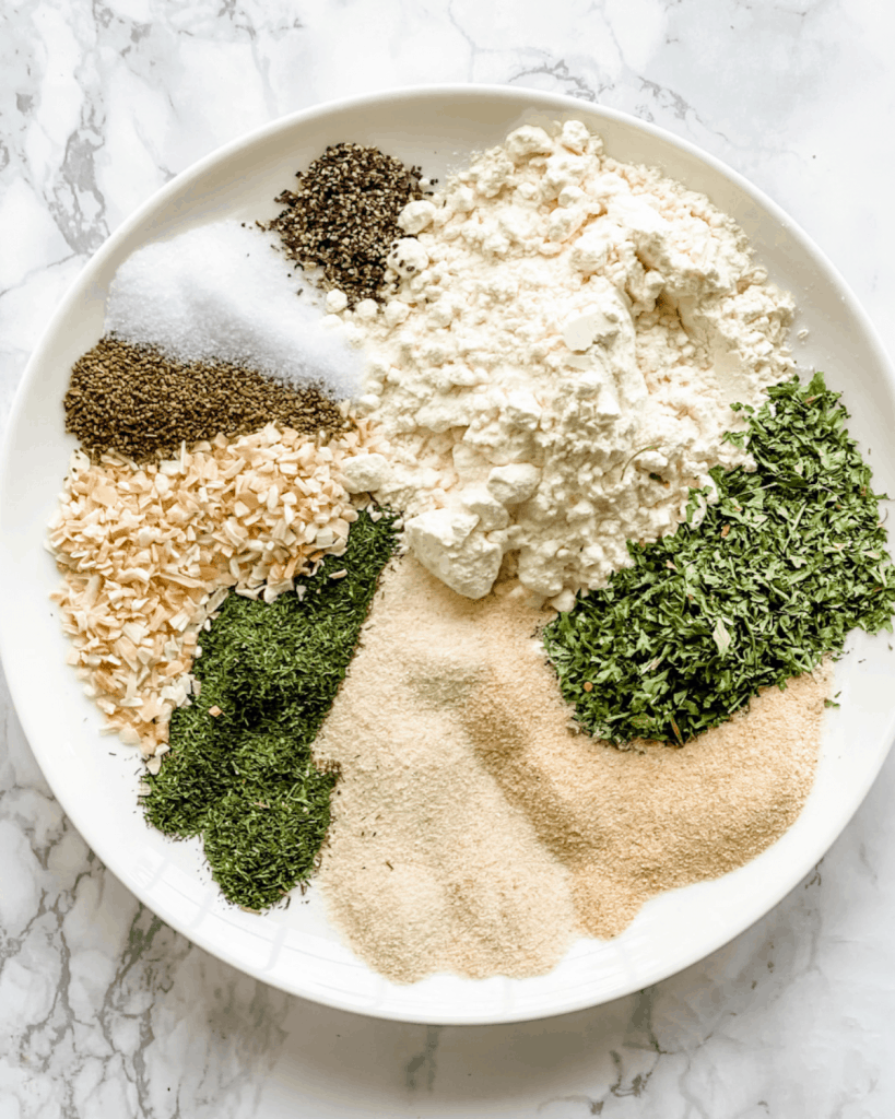 a plate with all the spice for ranch seasoning.
