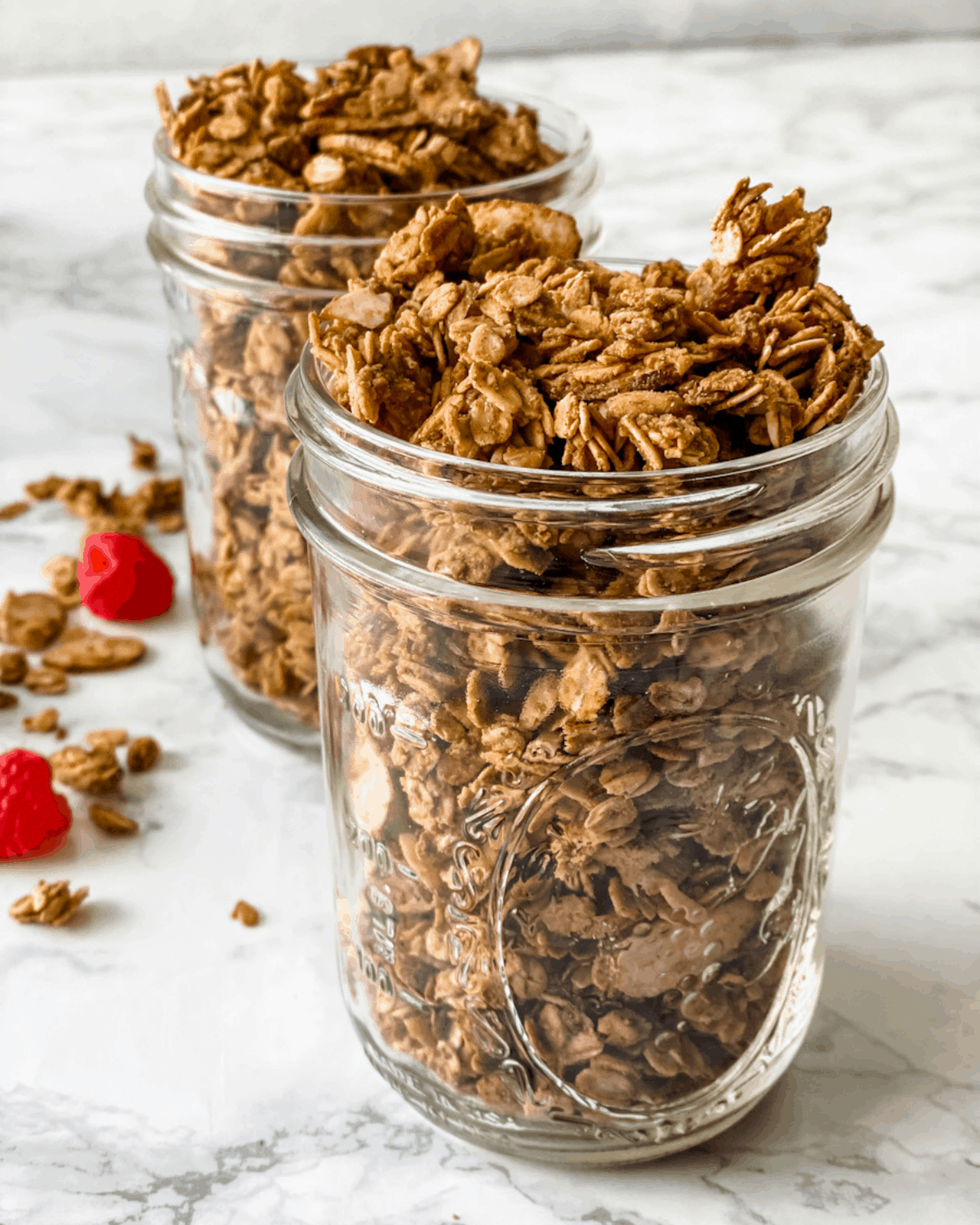 cooked almond butter granola in mason jars