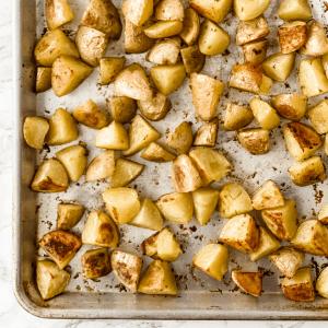crispy oven roasted potatoes on a baking sheet