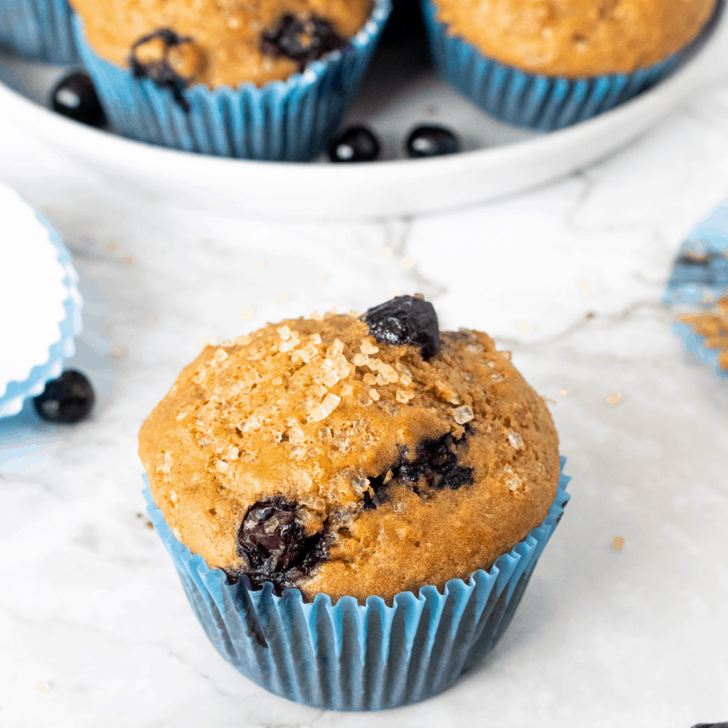 healthy blueberry muffins with Turbinado sugar sprinkled on top.