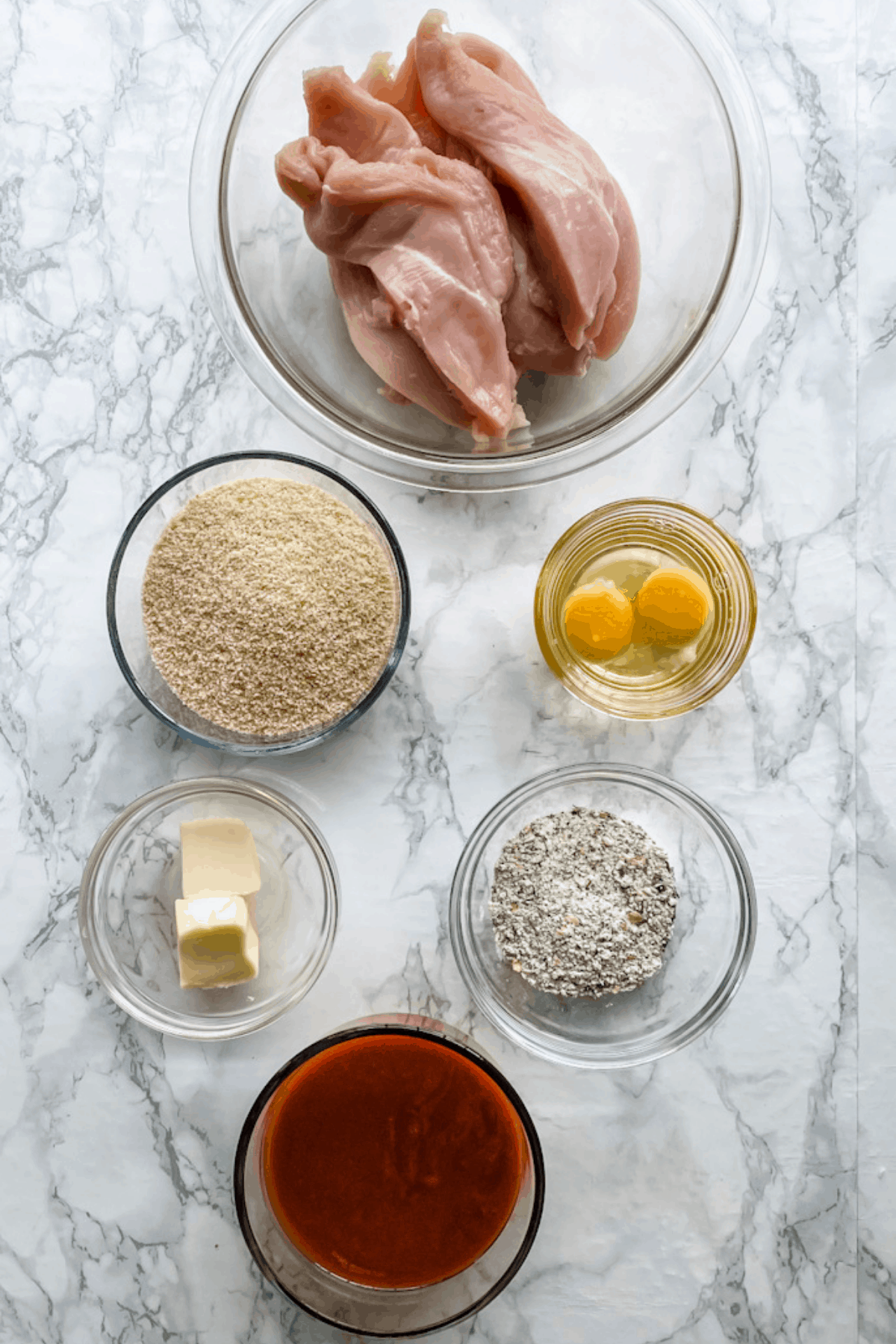 The ingredients to make baked buffalo chicken tenders.