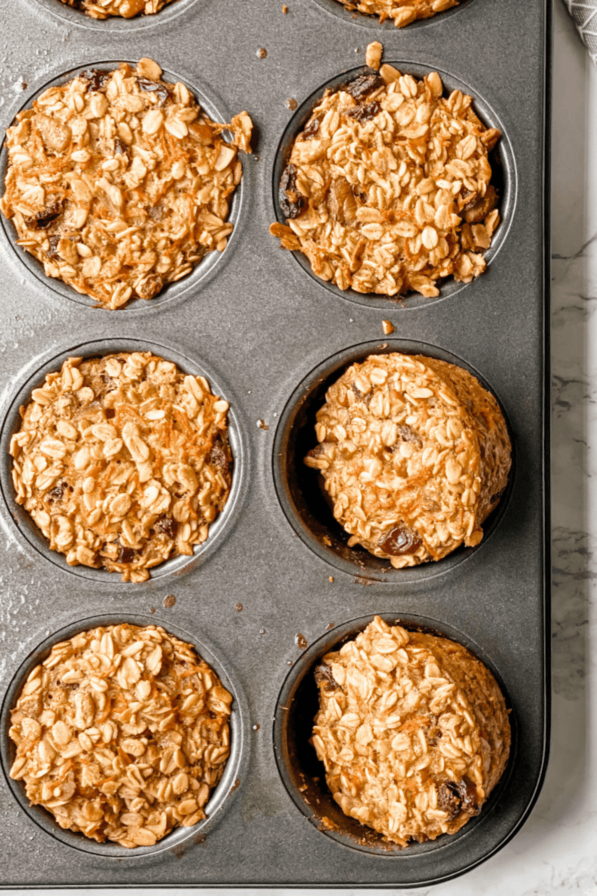 baked oatmeal cups in a muffin pan.