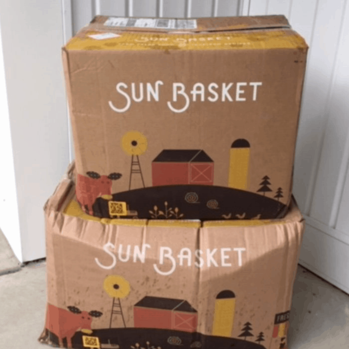 2 boxes from Sun Basket on the front porch