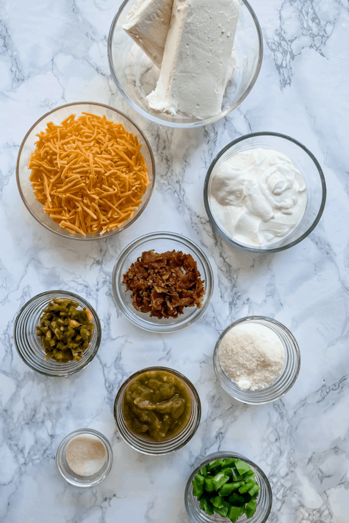 All of the ingredients needed to make jalapeno popper dip.
