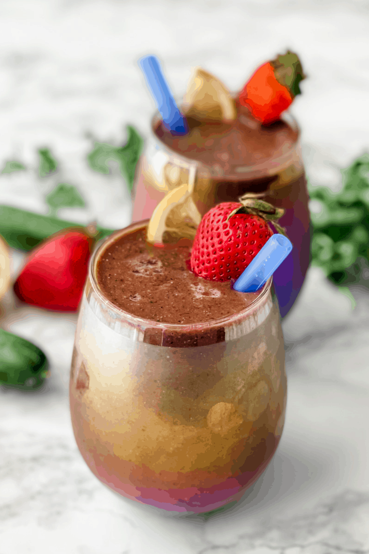 two detox smoothies in tumbler glasses.