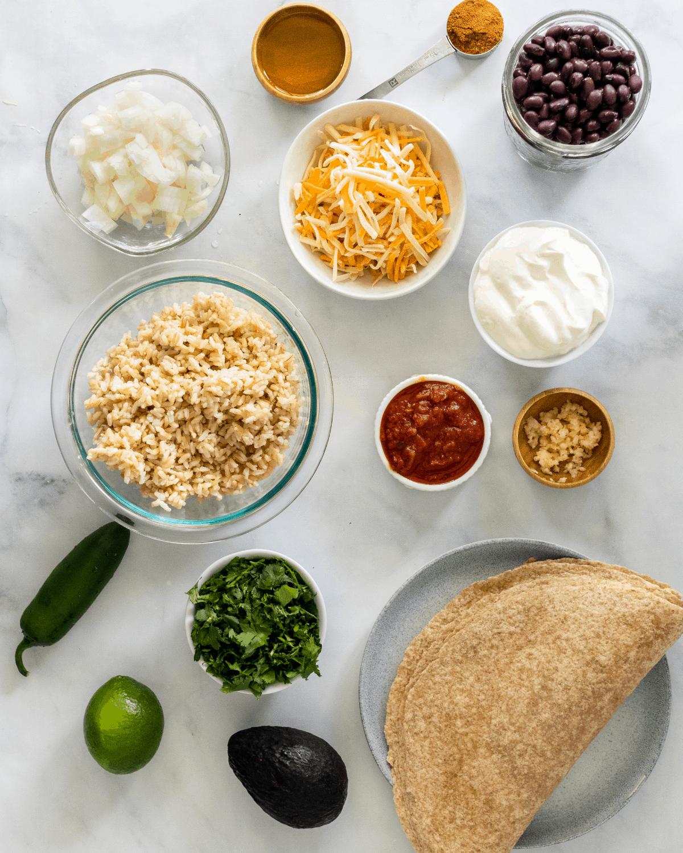 All of the ingredients to make vegetarian burritos.