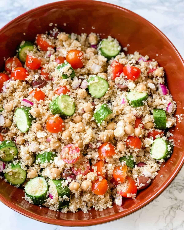 green quinoa salad in a large salad bowl.