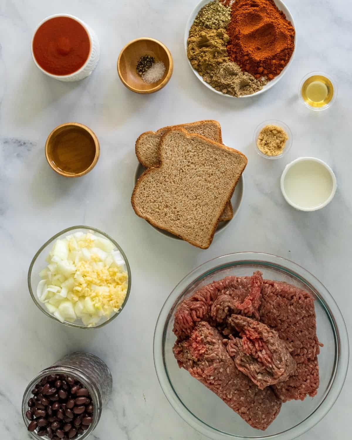 Ingredients to make beef taco meat in the crockpot