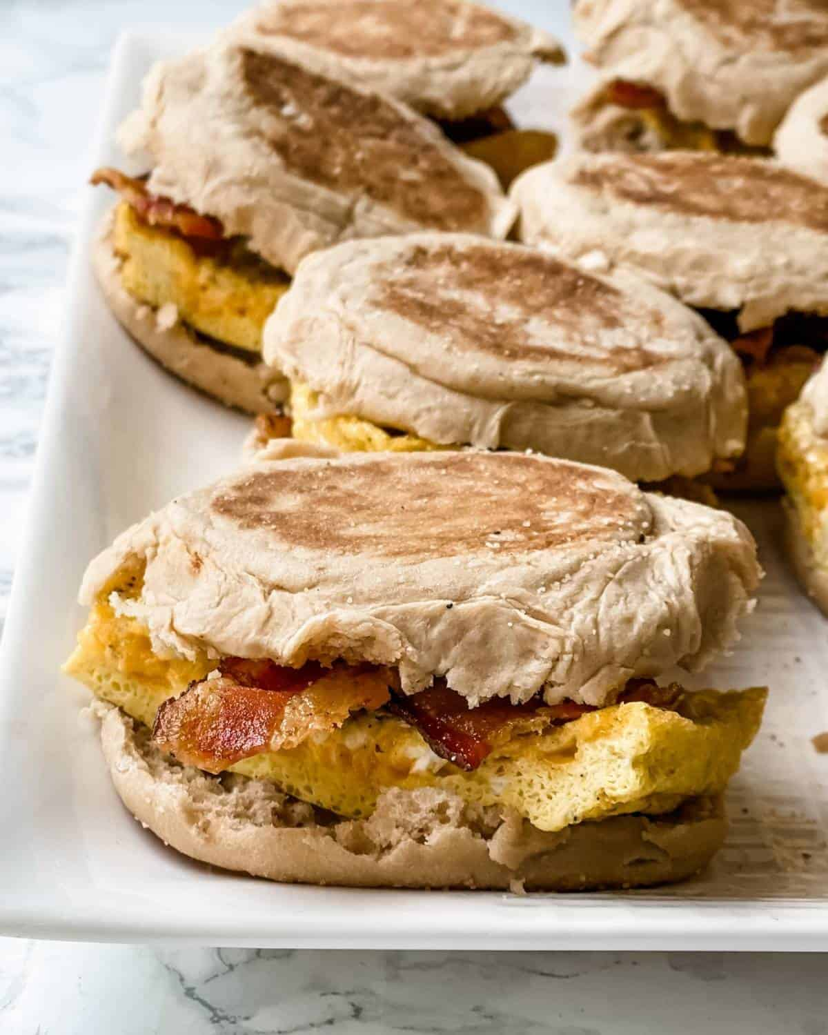 bacon, egg, and cheese on an English muffin breakfast sandwich.