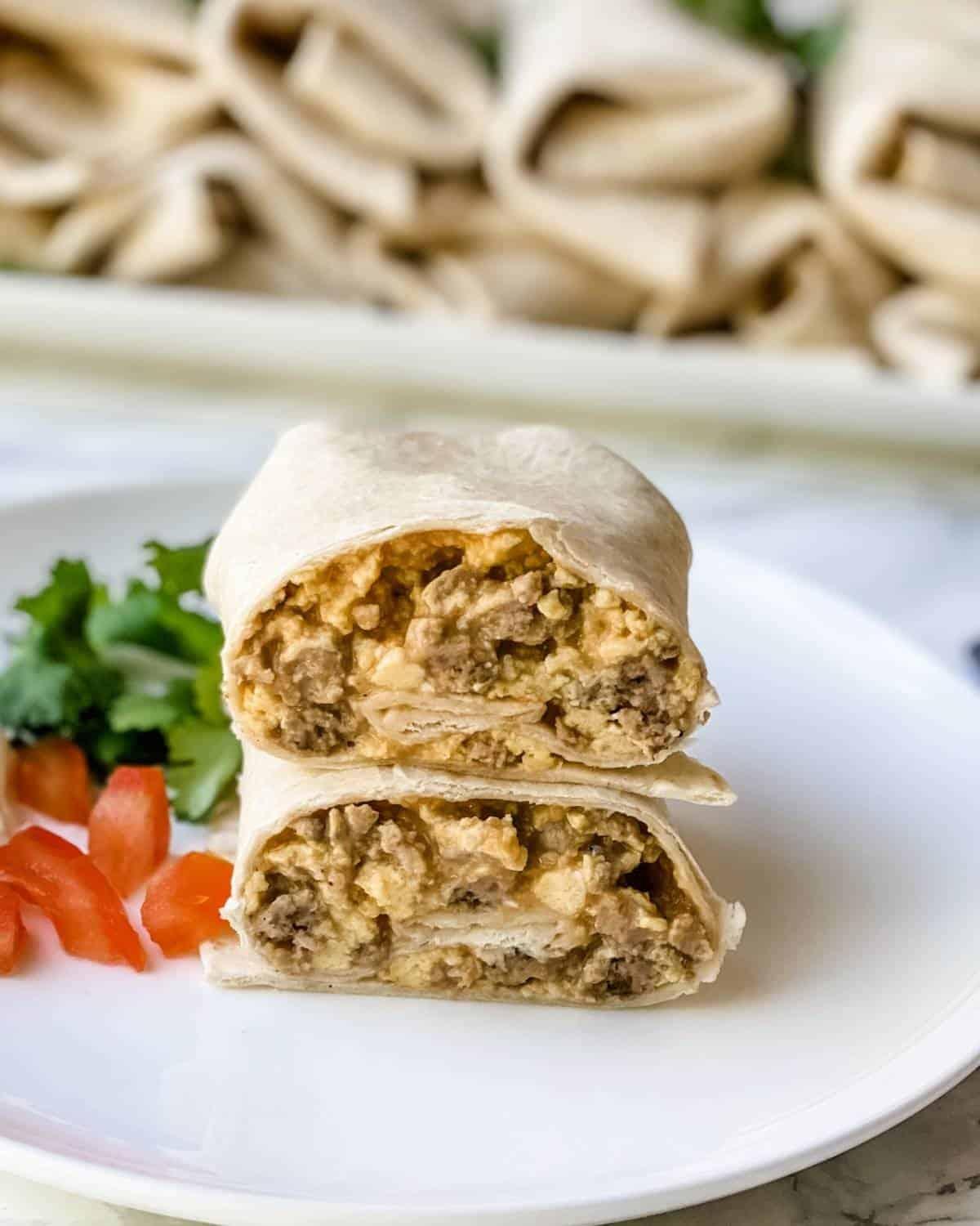 freezer burritos with sausage and cheese on a plate.