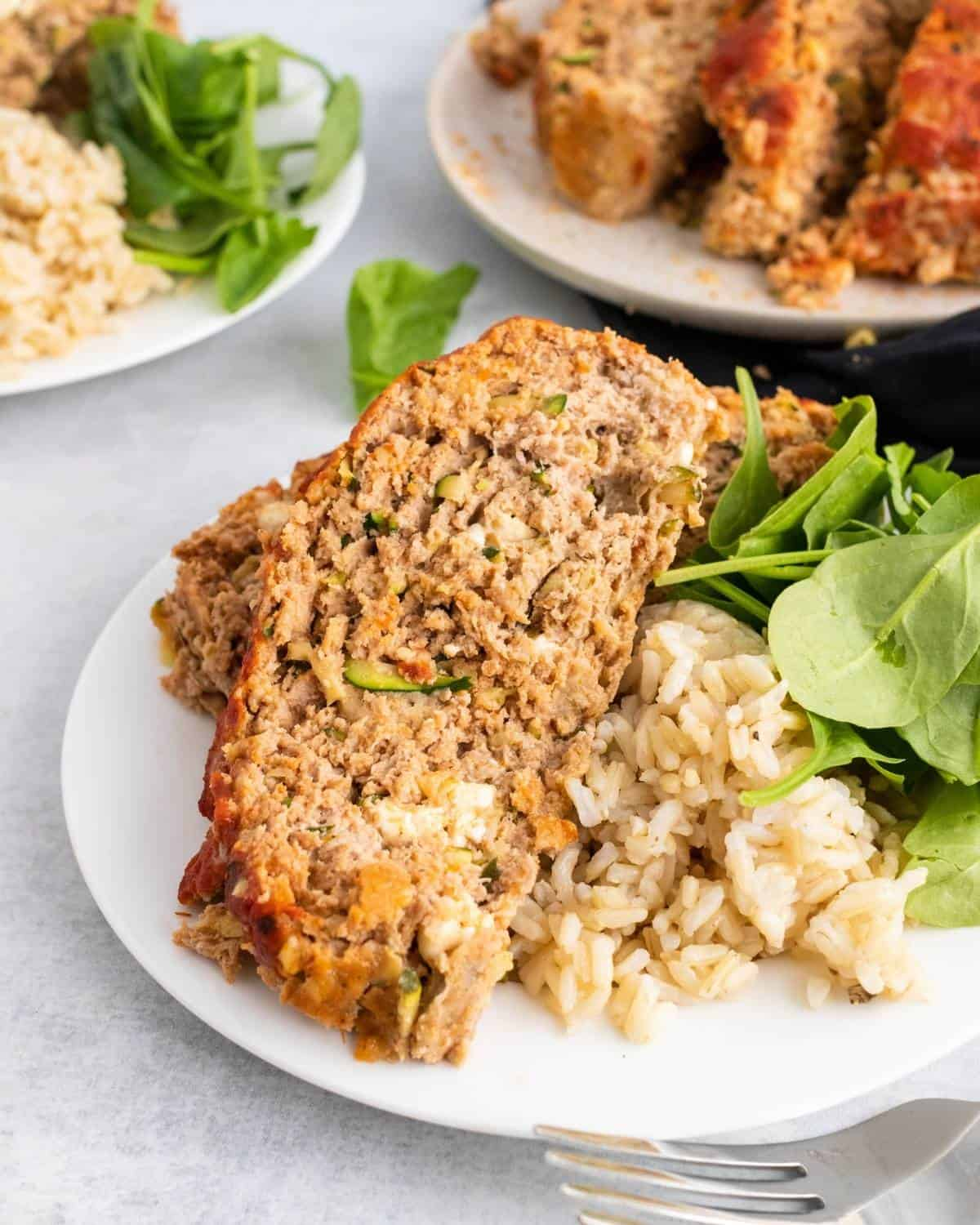 slices of turkey meatloaf with shredded zucchini and feta cheese
