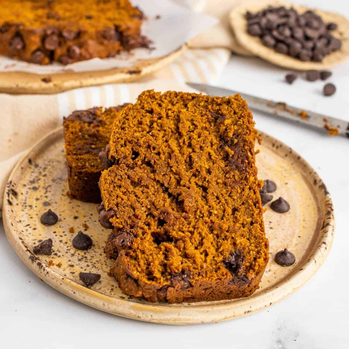 two slices of healthy pumpkin bread with chocolate chips